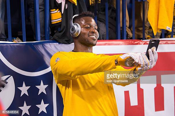 Pittsburgh Steelers wide receiver Antonio Brown take a selfie with a fan on the field before the NFL game between the Pittsburgh Steelers and...
