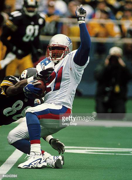 Pittsburgh Steelers wide receiver Courtney Hawkins drags down New England Patriots cornerback Steve Israel after Israel intercepts a pass during the...