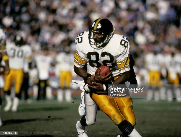Pittsburgh Steelers wide receiver John Stallworth inducted into the Pro Football Hall of Fame class of 2002 catches a pass during a game in 1984