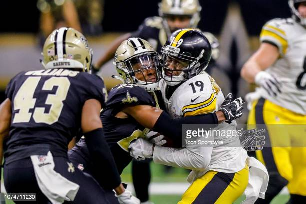 Pittsburgh Steelers wide receiver JuJu SmithSchuster and New Orleans Saints cornerback Eli Apple collide for a tackle on December 23 2018 at the...