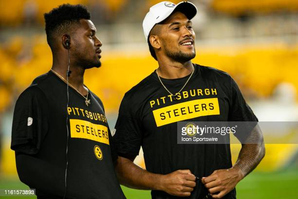 Pittsburgh Steelers wide receiver JuJu Smith-Schuster and Pittsburgh Steelers running back James Conner look on during the NFL football game between...