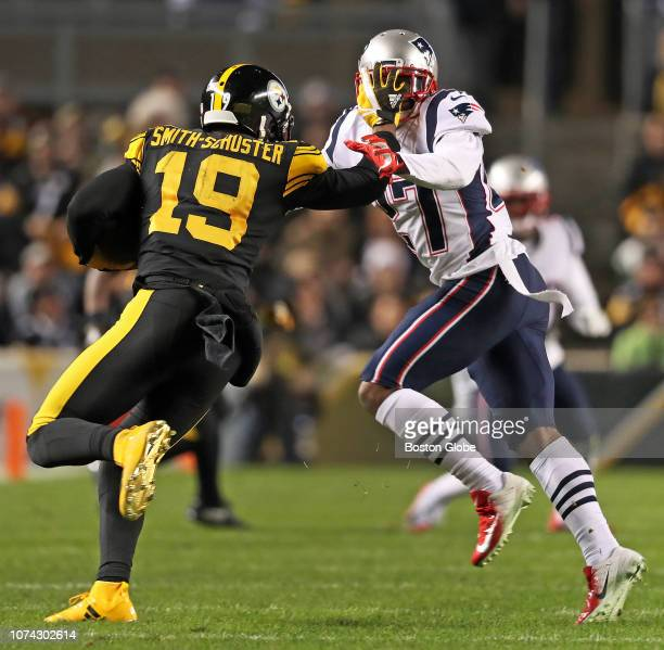 Pittsburgh Steelers wide receiver JuJu Smith-Schuster gives a stiff arm to the face mask of Patriots defender J.C. Jackson on his way to a second...