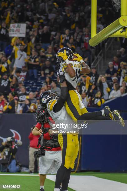 Pittsburgh Steelers wide receiver JuJu SmithSchuster is hoisted high in the air after his second half touchdown reception as Steeler fans celebrate...