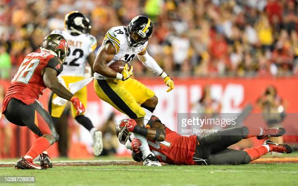 Pittsburgh Steelers wide receiver JuJu SmithSchuster is tackled by Tampa Bay Buccaneers linebacker Lavonte David after a reception during the second...