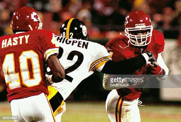 Pittsburgh Steelers wide receiver Yancy Thigpen tries to rip the ball from Kansas City safety Jerome Woods after Woods hauled in an interception that...