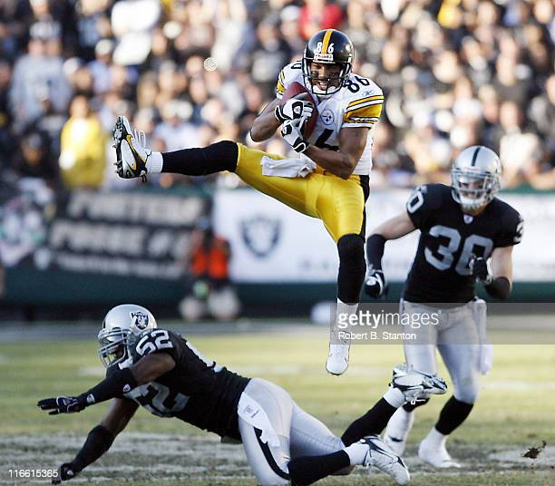 Pittsburgh wide receiver Hines Ward pulls one in during game against the Oakland Raiders at McAfee Coliseum Oakland California October 29 2006 The...