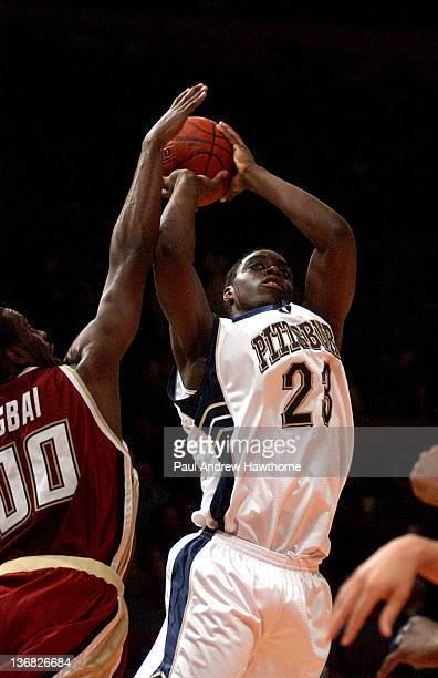Pittsburgh's Chris Taft has his shot blocked by Boston College's Uka Agbai during first half action at Madison Square Garden in New York City March...