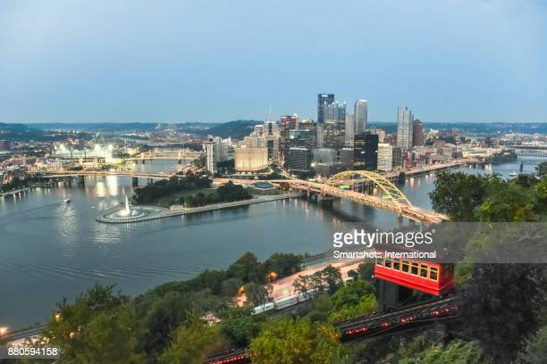 Pittsburgh's Golden Triangle illuminated at dusk with Duquesne incline in foreground - Pittsburgh, Pennsylvania, USA