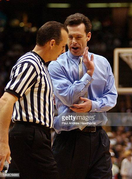 Pittsburgh's Head Coach Jamie Dixon has a word with a referee during the first half of play at the Continental Airlines Arena in East Rutherford New...
