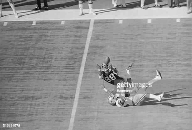 Pittsburgh's Lynn Swann makes a diving catch for 53 yards late in the 2nd quarter and falls over Mark Washington corner back for the Dallas Cowboys...