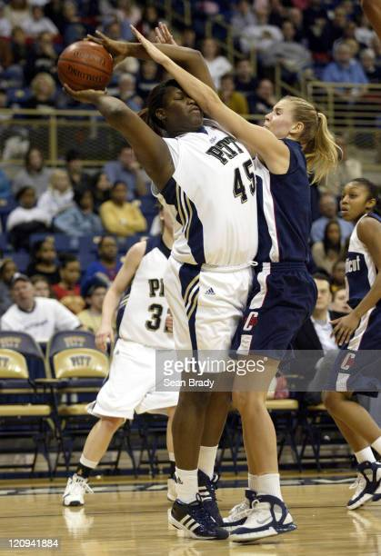 Pittsburgh's Marcedes Walker is defended by Connecticut's Ann Strother at the Petersen Events Center on January 21 2006 in Pittsburgh Pennsylvania