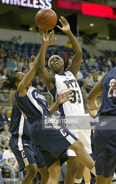 Pittsburgh's Xenia Stewart battles Connecticut's Ketia Swanier at the Petersen Events Center on January 21 2006 in Pittsburgh Pennsylvania