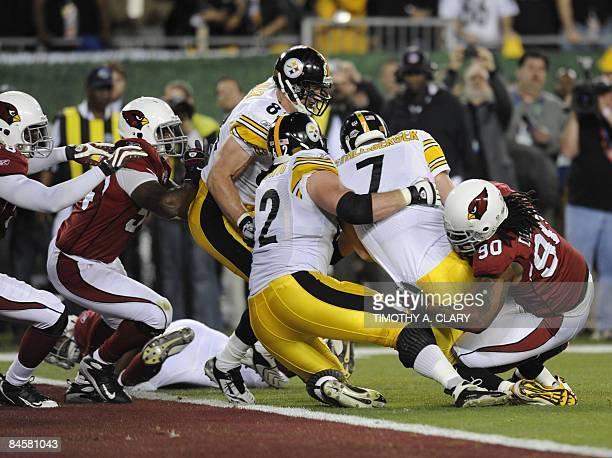 Pittsburh Steeler quarterback Ben Roethlisberger is pulled down just short of a touchdown by Darnell Dockett of the Arizona Cardinals in the first...