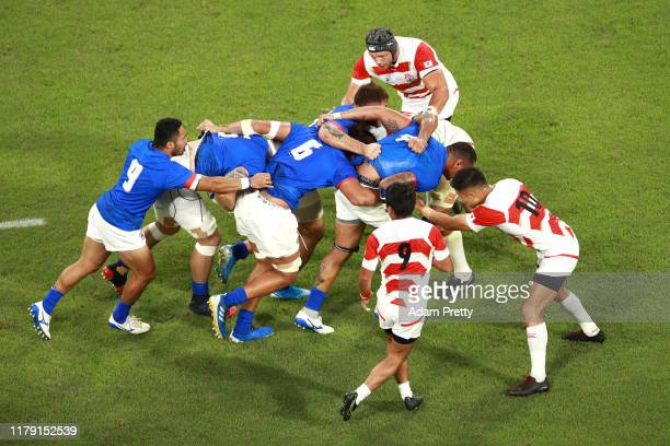 Piula Faasalele and Chris Vui, Kane Le'aupepe and Dwayne Polataivao of Samoa attempt to push the ball forward during the Rugby World Cup 2019 Group A...