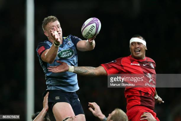 Piula Faasalele of Toulouse and Macauley Cook of Cardiff Blues during the European Challenge Cup match between Stade Toulousain and Cardiff Blues at...