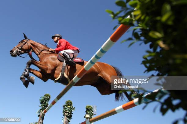 Pius Schwizer of Switzerland rides on Carlina during the Rolex Grand Prix Jumping competition of the CHIO on July 18, 2010 in Aachen, Germany.