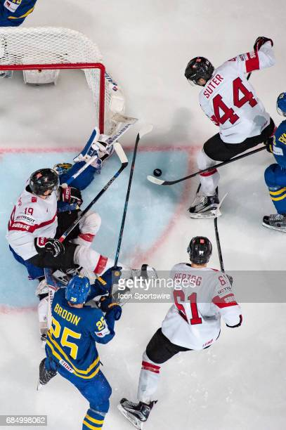Pius Suter tries to score against Goalie Henrik Lundqvist during the Ice Hockey World Championship Quarterfinal between Switzerland and Sweden at...
