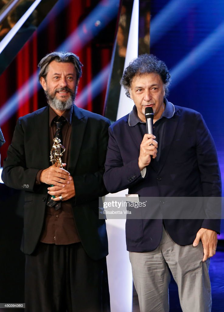 Pivio and Aldo De Scalzi receive the best composer award for 'Song'e Napule' as they attend the David Di Donatello Awards Ceremony at the Dear Studios on June 10, 2014 in Rome, Italy.