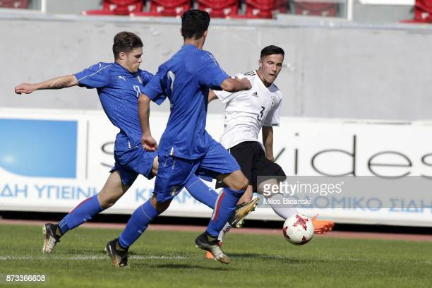 Piwernetz Nils of Germany in action against of Gavioli Lorenzo Italy during the Germany vs Italy U18 friendly match at Ammochostos Stadium at Larnaca...