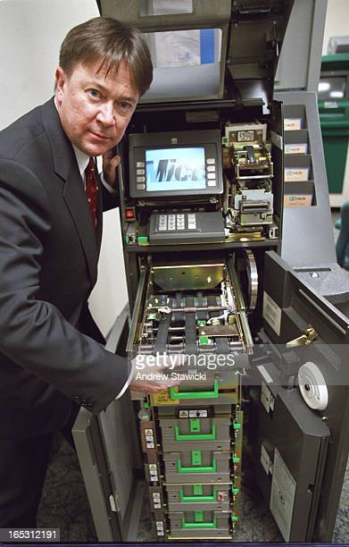 pix of ATM at NCR lab with Nick Haines who's working with ATMs since they were 1st introduced in Canada in the 70s