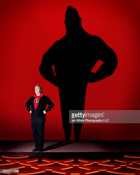 Pixar director Brad Bird casts the shadow of Mr Incredible the star of his 2004 animated film The Incredibles