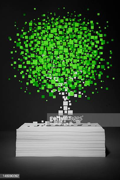 Pixel tree growing from stack of paper
