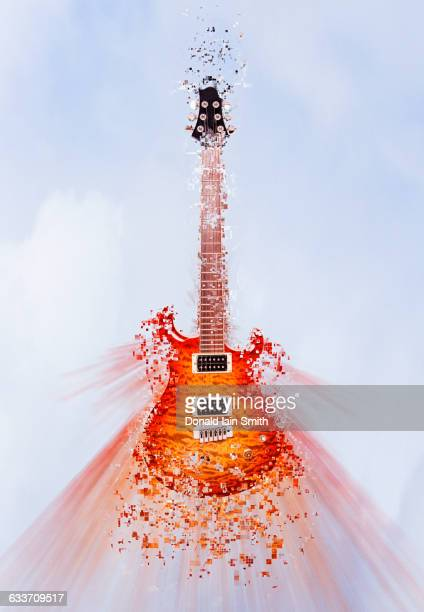 Pixelated guitar floating in sky