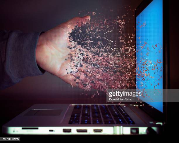 pixelated hand of caucasian man dissolving into laptop screen - data privacy stock pictures, royalty-free photos & images