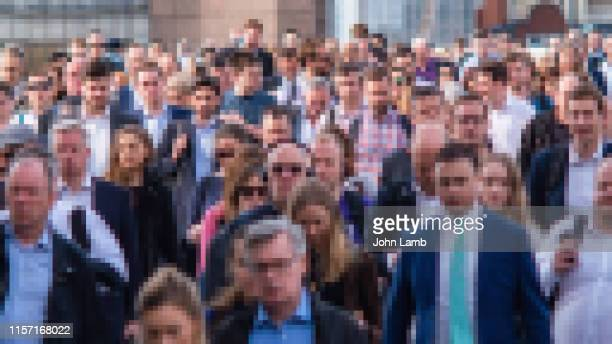 pixelated image of commuters making their way to work - facial recognition technology stock pictures, royalty-free photos & images