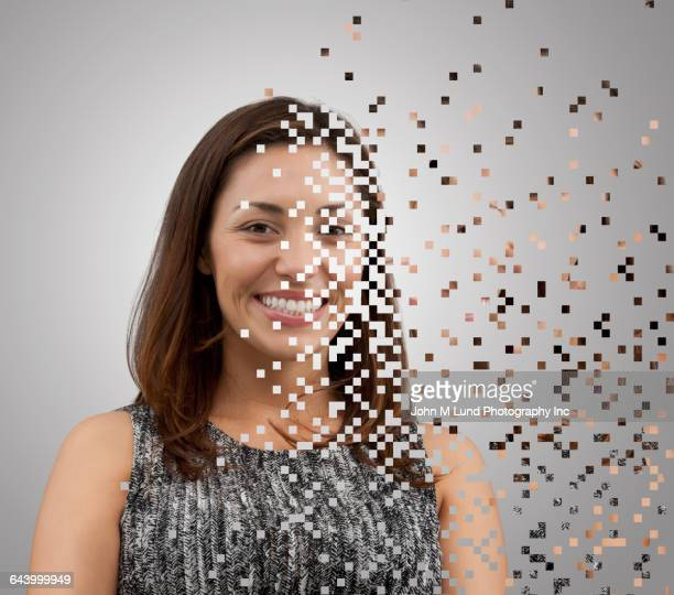 pixelated mixed race woman dissolving - pixels stock photos and pictures