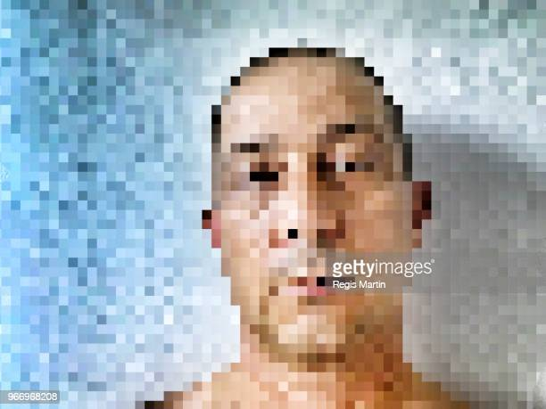 Pixelated portrait of a man.