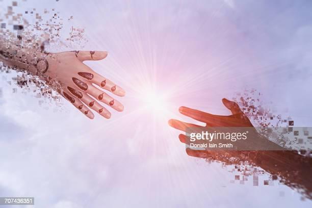 Pixelated robot hands reaching in sky