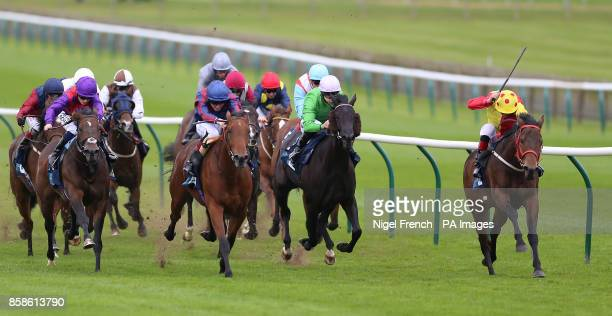 Pixeleen ridden by Adam Kirby wins The British EBF Breeders Fillies Series Sprint Handicap Stakes ahead of Magical Dreamer ridden by George Wood in...