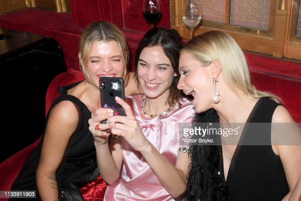 Pixie Geldof Alexa Chung and Poppy Delevingne attend the Miu Miu dinner and aftershow party at Raspoutine Club as part of the Paris Fashion Week...