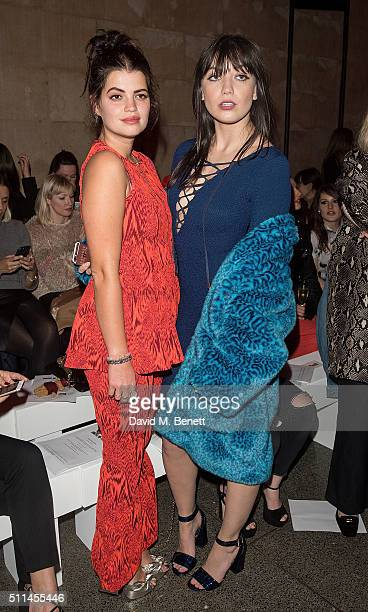 Pixie Geldof and Daisy Lowe attend the House of Holland show during London Fashion Week Autumn/Winter 2016/17 at TopShop Show Space on February 20...