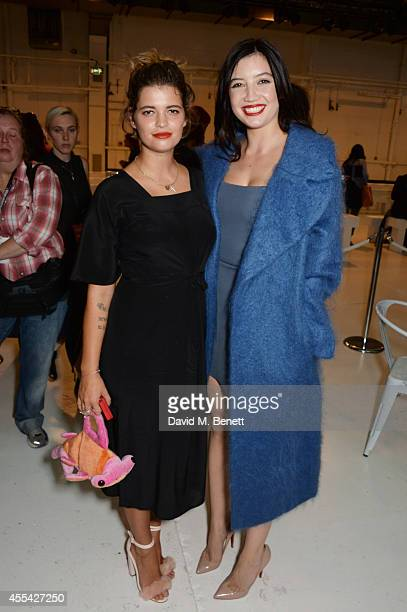 Pixie Geldof and Daisy Lowe attend the Topshop Unique SS15 Front Row on September 14 2014 in London England
