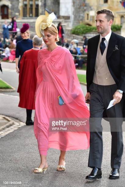 Pixie Geldof and George Barnett arrive ahead of the wedding of Princess Eugenie of York to Jack Brooksbank at Windsor Castle on October 12 2018 in...