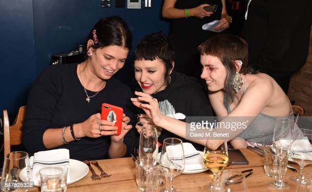 Pixie Geldof Brooke Candy and guest attend the Beats Refinery29 dinner for Ashley Williams at The Curtain on September 15 2017 in London England