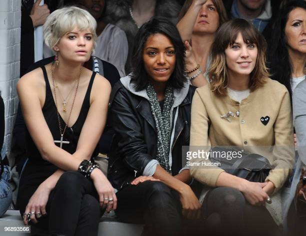 Pixie Geldof Remi Nicole and Alexa Chung watch the Autumn/Winter 2010 Topshop Unique London Fashion Week at Topshop Show Space on February 20 2010 in...
