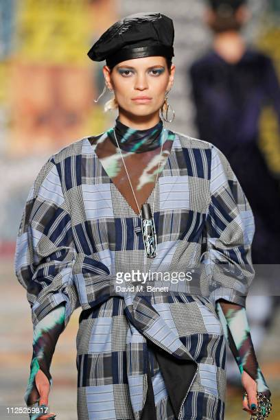 Pixie Geldof walks the catwalk at the House of Holland AW19 London Fashion Week catwalk show showcasing the limitededition Vype ePen 3 and vaping...