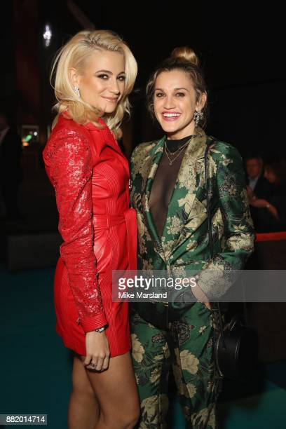 Pixie Lott and Ashley Roberts attend the UK launch event for the new Ferrari Portofino at Kensington Olympia on November 29 2017 in London England