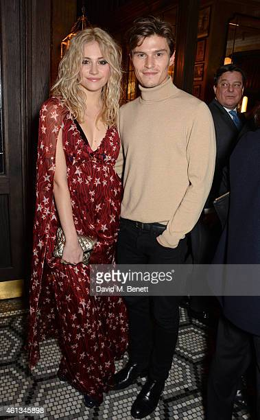 Pixie Lott and Oliver Cheshire attend a dinner hosted by designer Tommy Hilfiger and Dylan Jones editorinchief of British GQ to celebrate London...