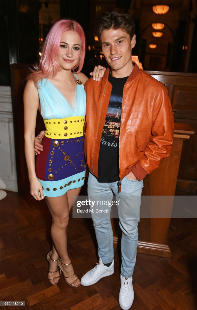 Pixie Lott (L) and Oliver Cheshire attend a pre-opening dinner hosted by Ed Drewett at Malibu Kitchen, at The Ned, London on April 24, 2017 in London, England.