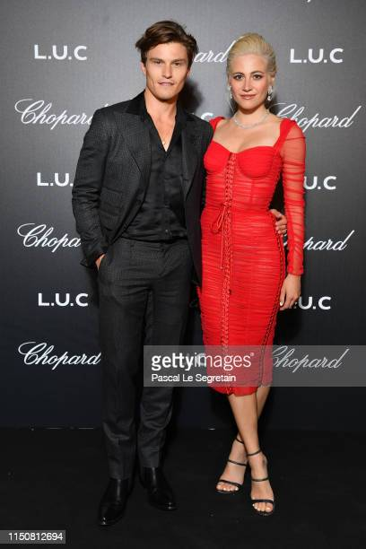 Pixie Lott and Oliver Cheshire attend Chopard's The Gentleman's Evening At The Hotel Martinez at Hotel Martinez on May 21 2019 in Cannes France