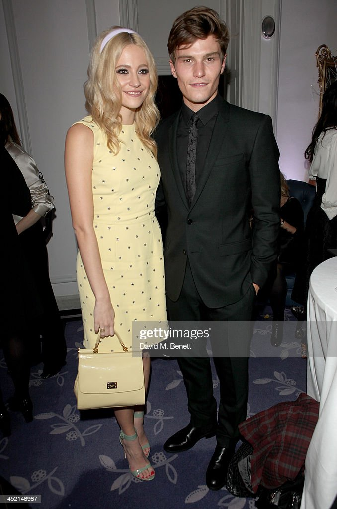 Pixie Lott and Oliver Cheshire attend Claridge's Christmas Tree By Dolce & Gabbana launch party at Claridge's Hotel on November 26, 2013 in London, England.