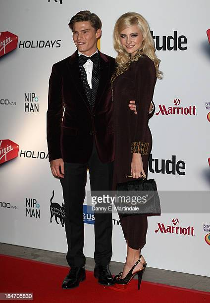 Pixie Lott and Oliver Cheshire attend the Attitude Magazine awards at Royal Courts of Justice Strand on October 15 2013 in London England