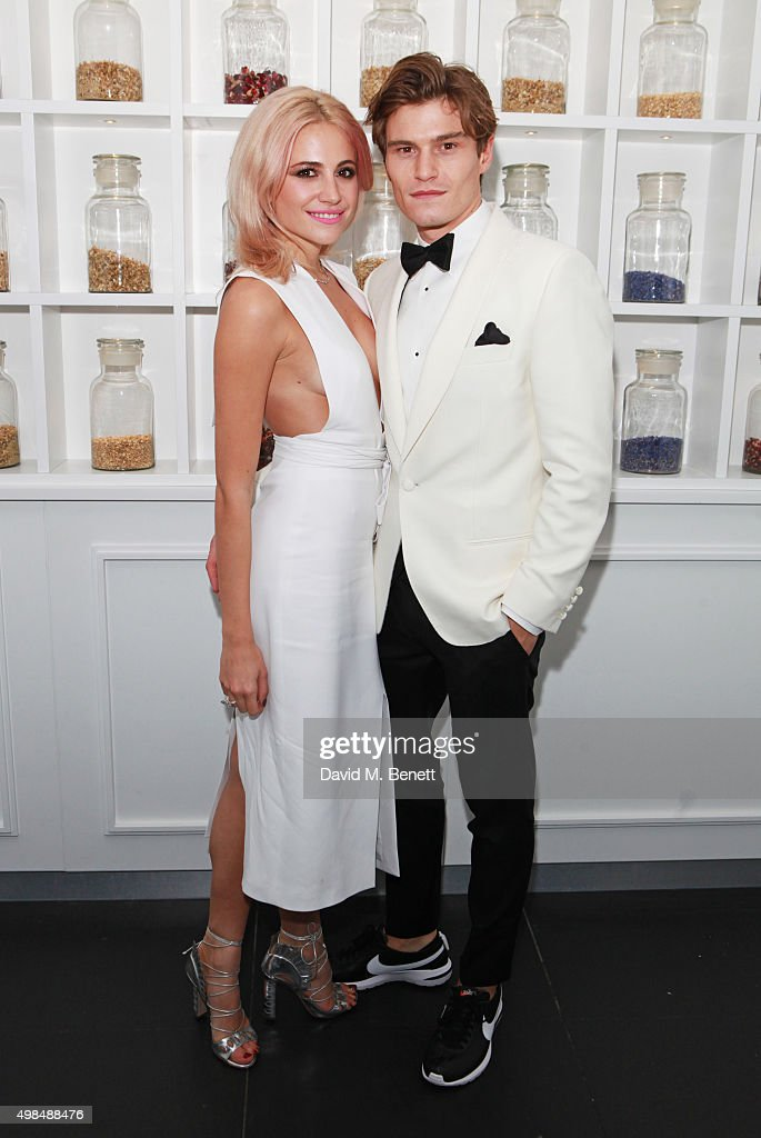 Pixie Lott (L) and Oliver Cheshire attend the British Fashion Awards official afterparty hosted by St Martins Lane and sponsored by Ciroc Vodka at St Martins Lane on November 23, 2015 in London, England.