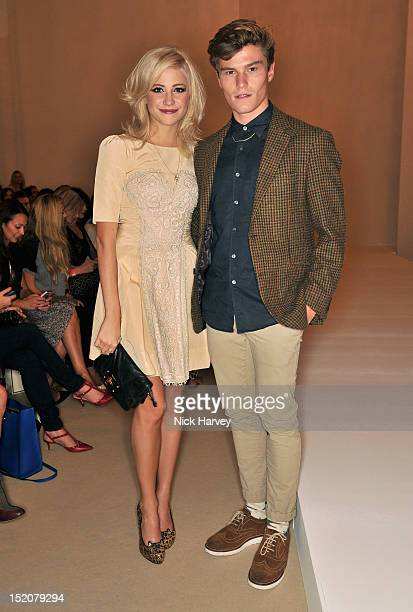 Pixie Lott and Oliver Cheshire attend the front row for the Temperley show on day 3 of London Fashion Week Spring/Summer 2013 at Freemasons Hall on...