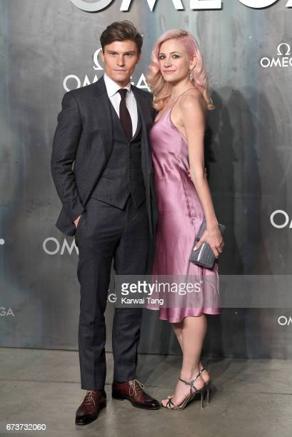 Pixie Lott and Oliver Cheshire attend the Lost In Space event to celebrate the 60th anniversary of the OMEGA Speedmaster at the Tate Modern on April...