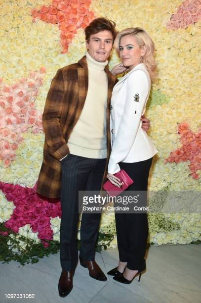 Pixie Lott and Oliver Cheshire attend the Schiaparelli Haute Couture Spring Summer 2019 show as part of Paris Fashion Week on January 21, 2019 in...
